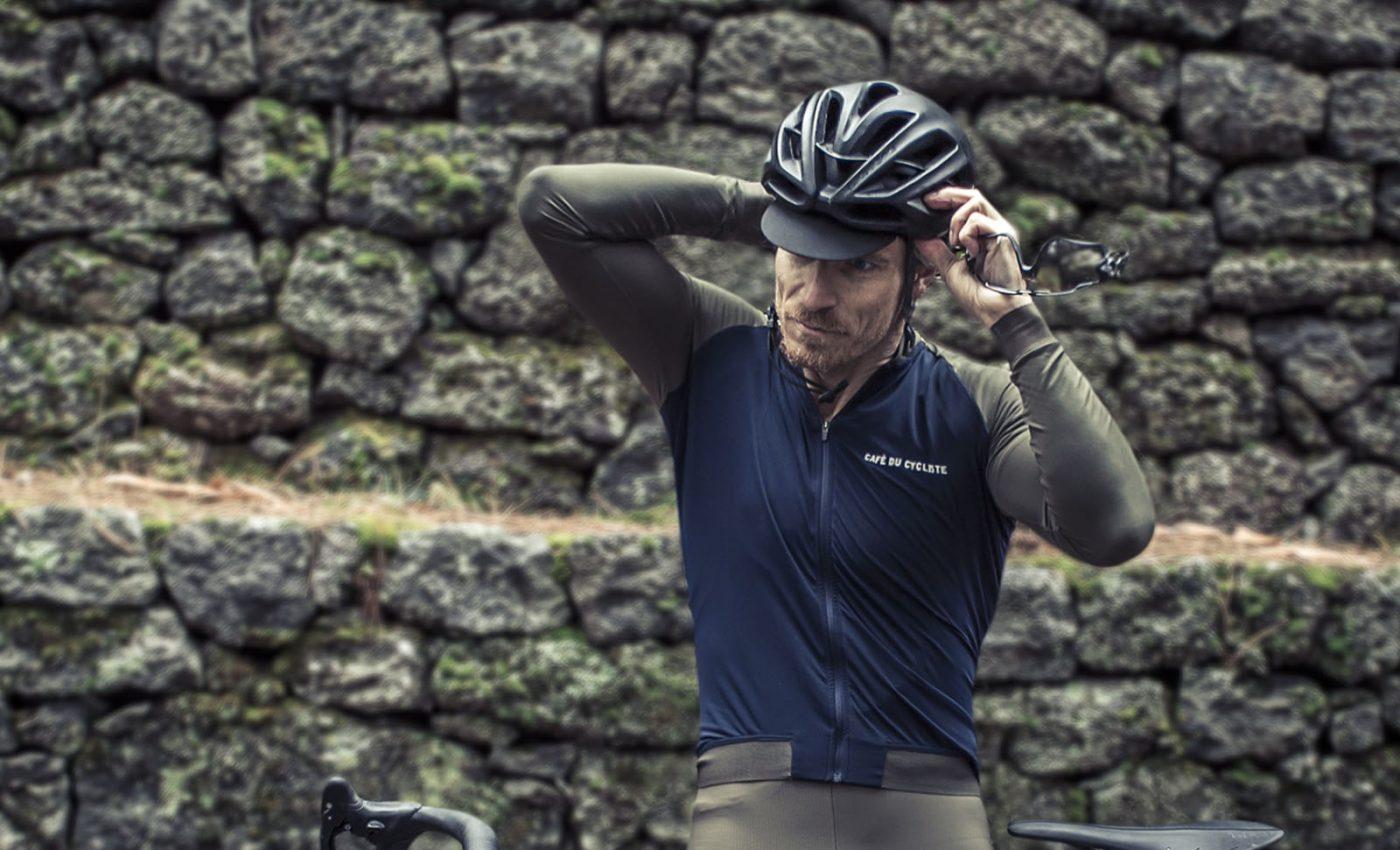 Cyclist Adjusting the helmet on Etna