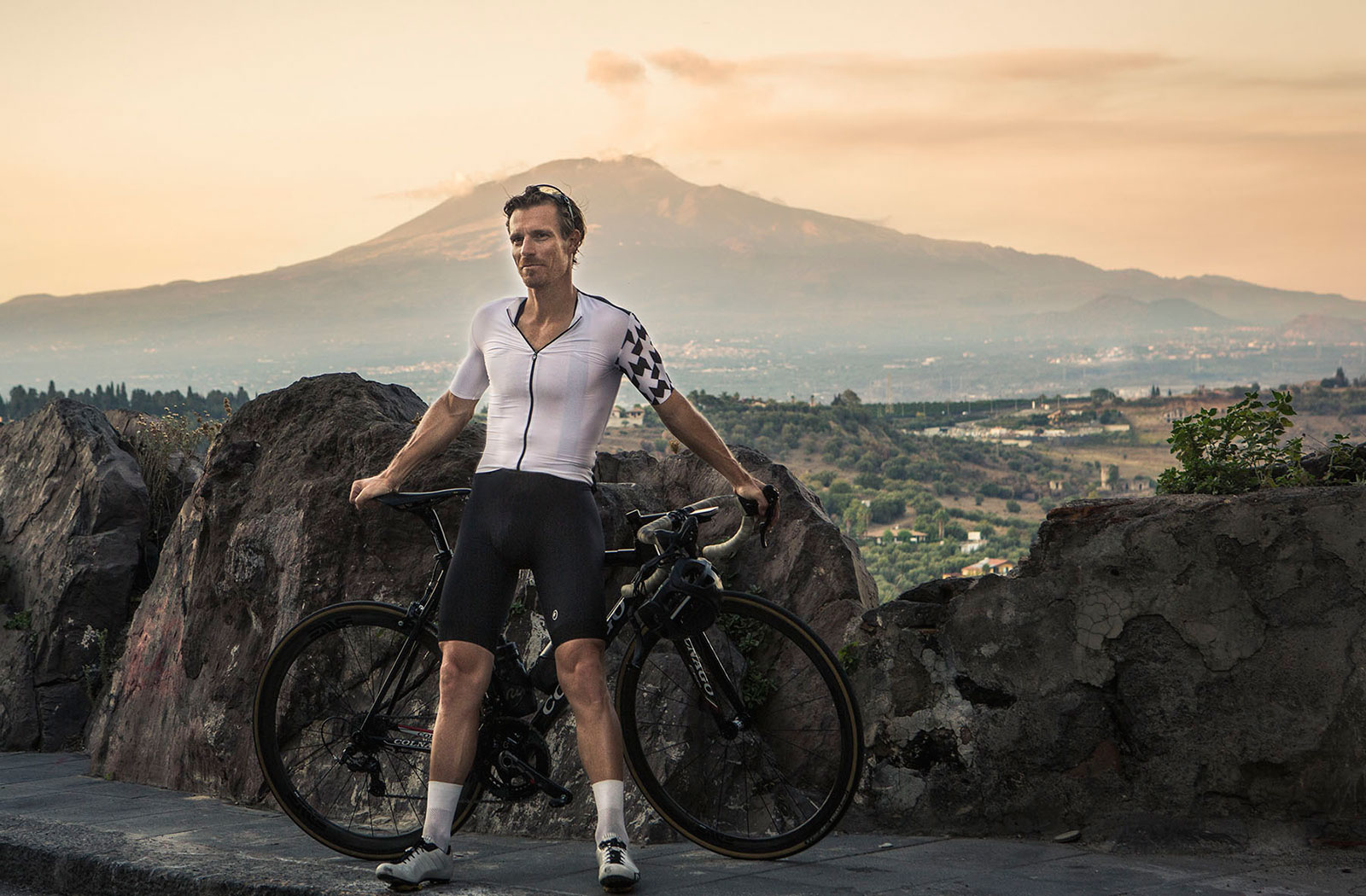 Black Road Cycling and Assos model Thomas Opstrup in front of Etna in the golden hour