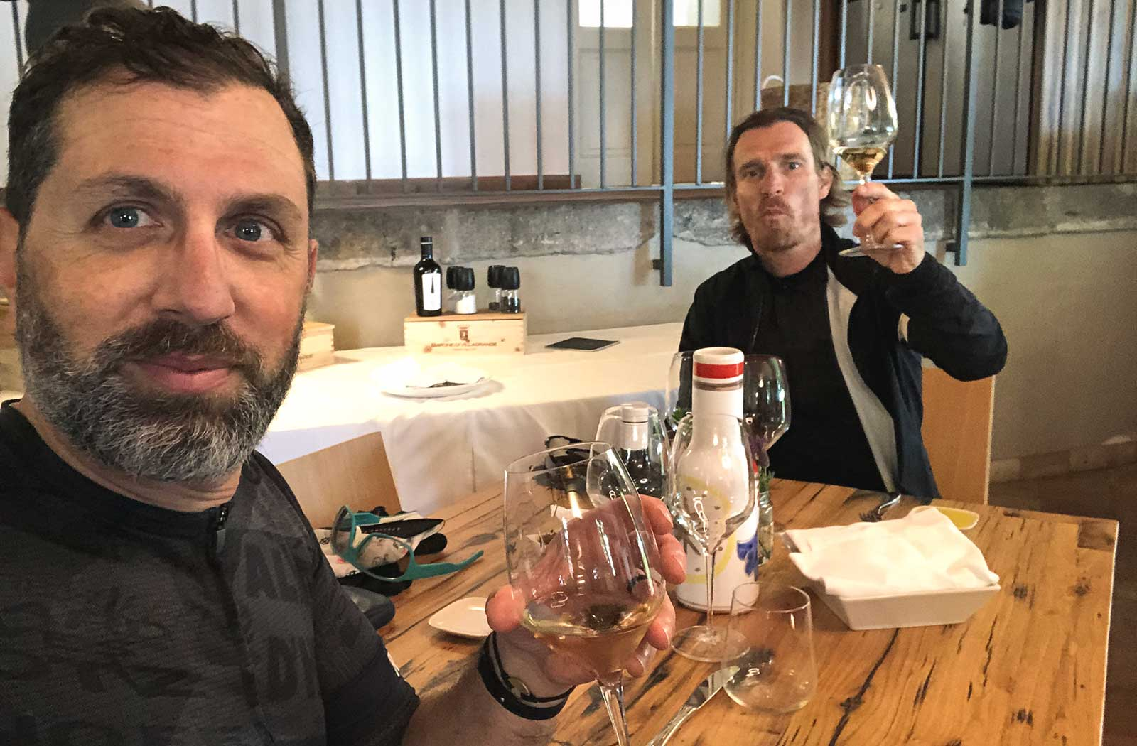 Sandro and Opstrup are drinking wine on Etna