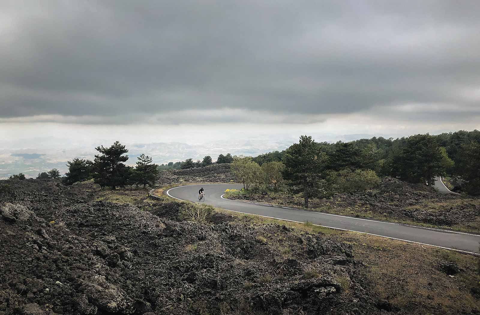Sandro riding through the lava fields on Etna